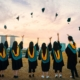 college graduates throw their hats in the air